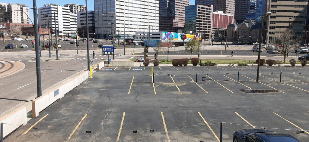 Several empty parking lots in the downtown area.