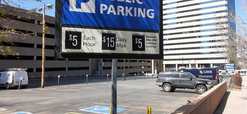 A sign identifying the pricing for parking. $5/hour up to $15.
